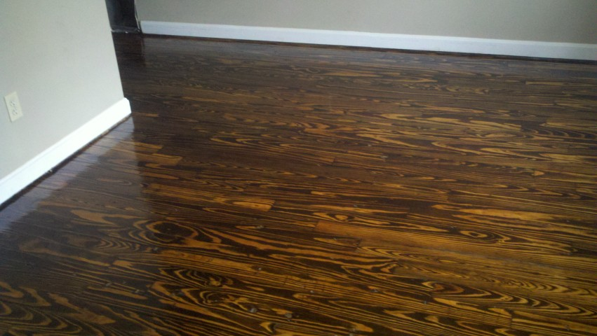 A restored wood floor done by Fabulous Floors Alabama