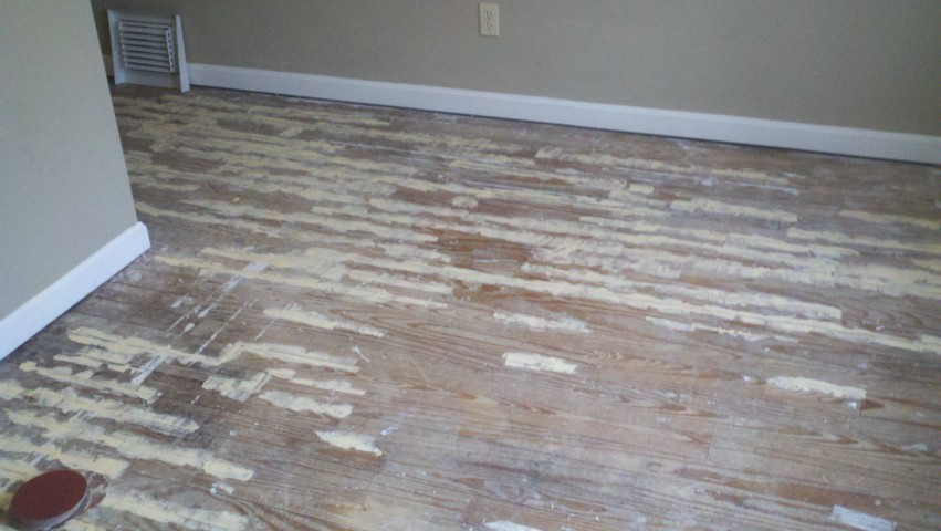 A severely damaged and scratched up wood floor