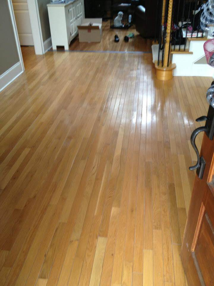 a hardwood floor with minor but noticeable damages.
