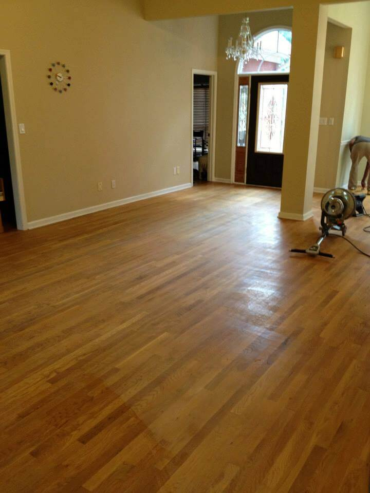 A hardwood floor with minor scratches