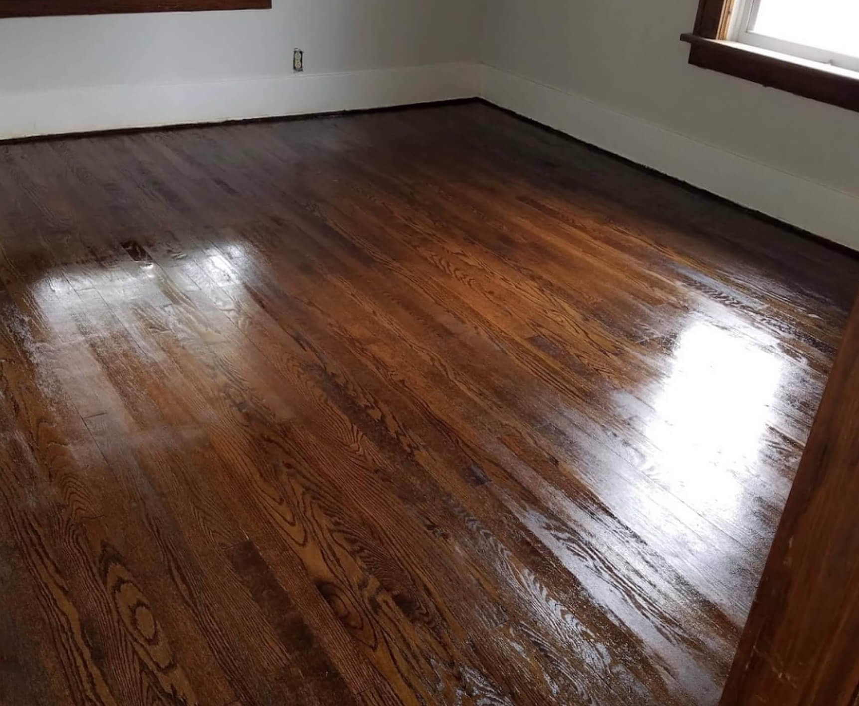 A refinished hardwood floor with a fresh coat of Fabulous Floors Alabama stain.