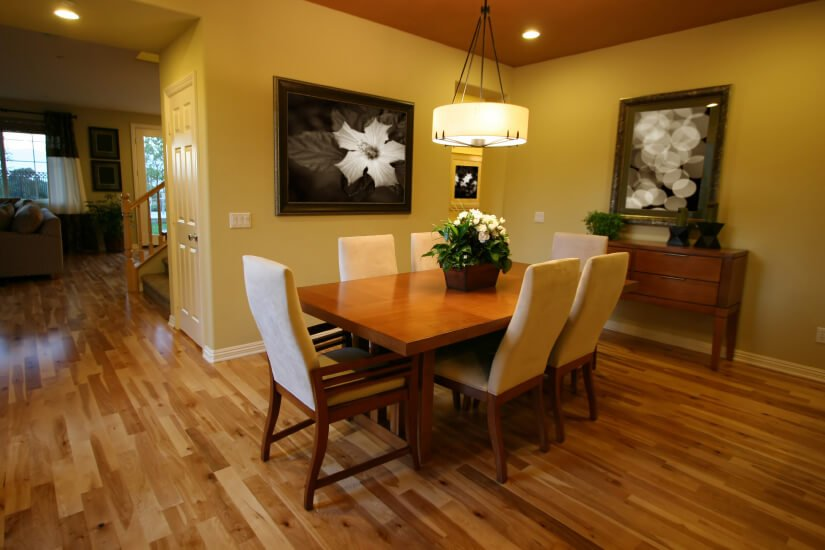 A montgomery dining rooms with floors refinished by Fabulous Floors.