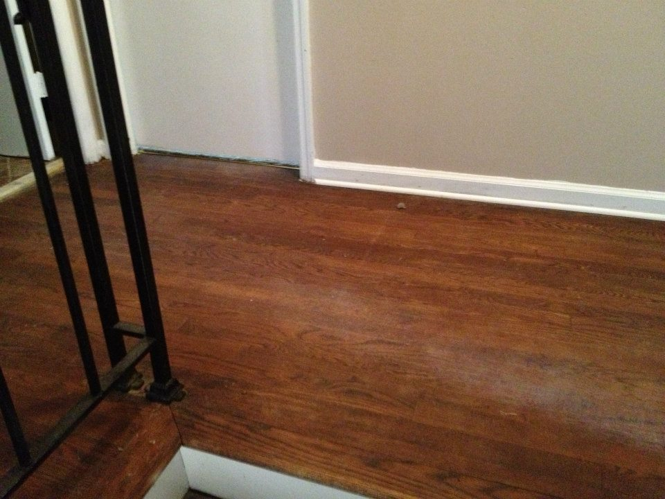A hardwood floor that needs to be refinished